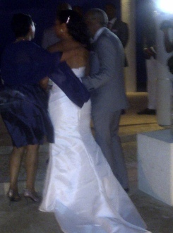 The bride and groom (partially shown out of privacy)
