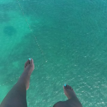 My feet dangling while Parasailling